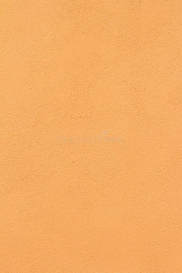 Fondo anaranjado poner crema de la textura de la pared del estuco fotos de archivo libres de regalías