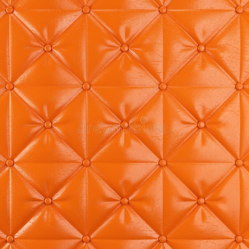 Fondo arancio cucito del cuoio della tappezzeria con i bottoni illustrazione di stock