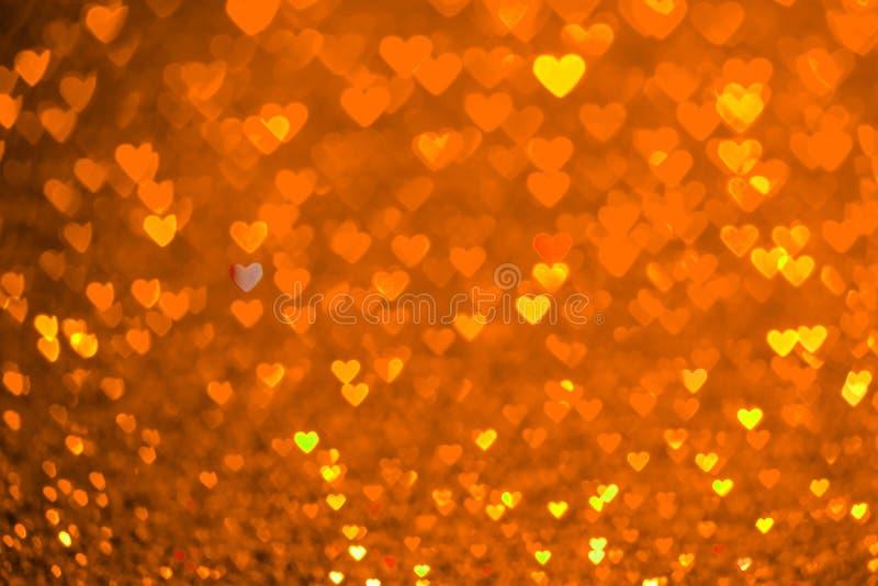 Fondo arancio del bokeh del cuore Struttura di giorno di biglietti di S. Valentino immagine stock