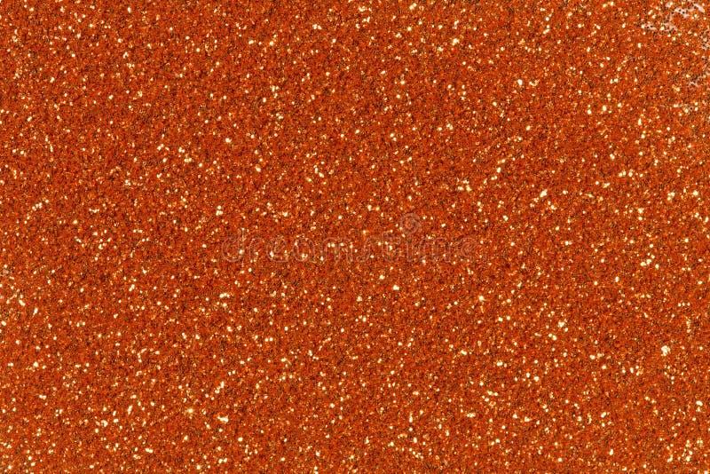 Fondo arancio di natale di struttura di scintillio Struttura dorata luminosa di scintillio immagini stock