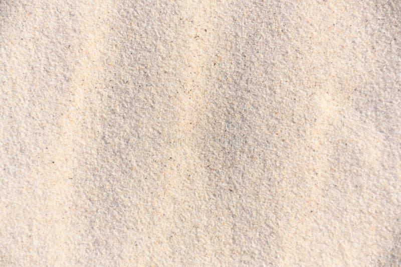 Fondo - arena blanca imagenes de archivo