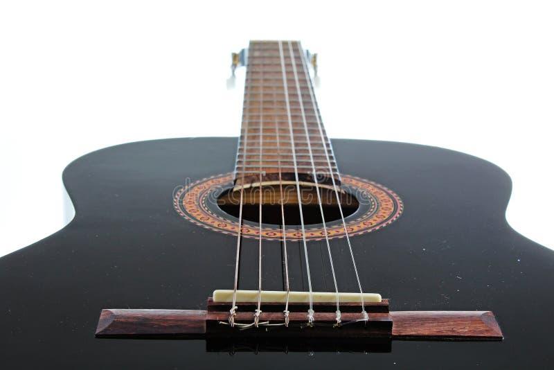 Fondo artsy del POV de la guitarra Ejemplo de la música Primer blanco y negro de la guitarra imagenes de archivo