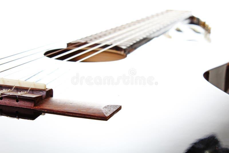 Fondo artsy del POV de la guitarra Ejemplo de la música Primer blanco y negro de la guitarra foto de archivo