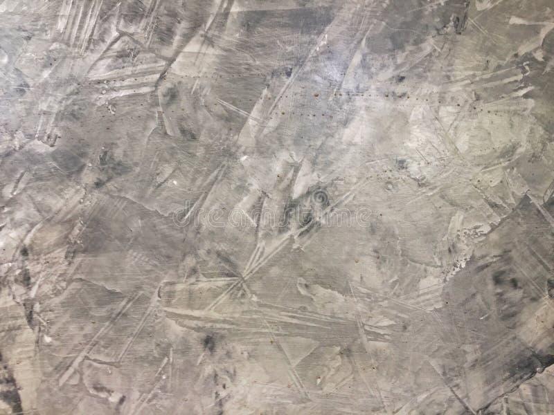 fondo astratto con la parete grigia del cemento di costruzione immagine stock