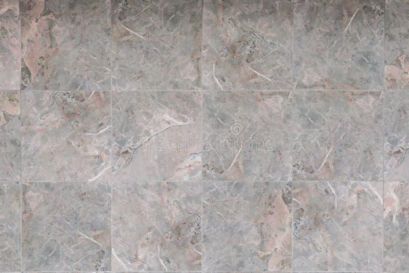 Fondo astratto con la struttura della pietra naturale per la riparazione Mattonelle di finitura di marmo e del granito in grigio  fotografia stock