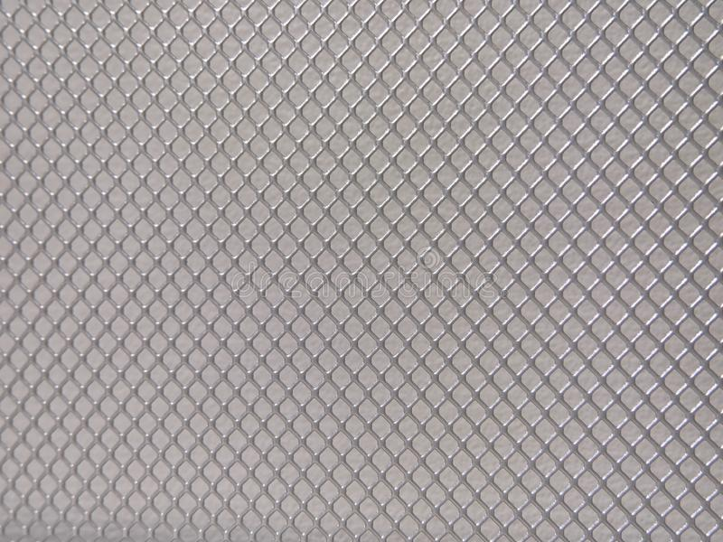 Fondo astratto del metallo, maglia con struttura fine illustrazione di stock