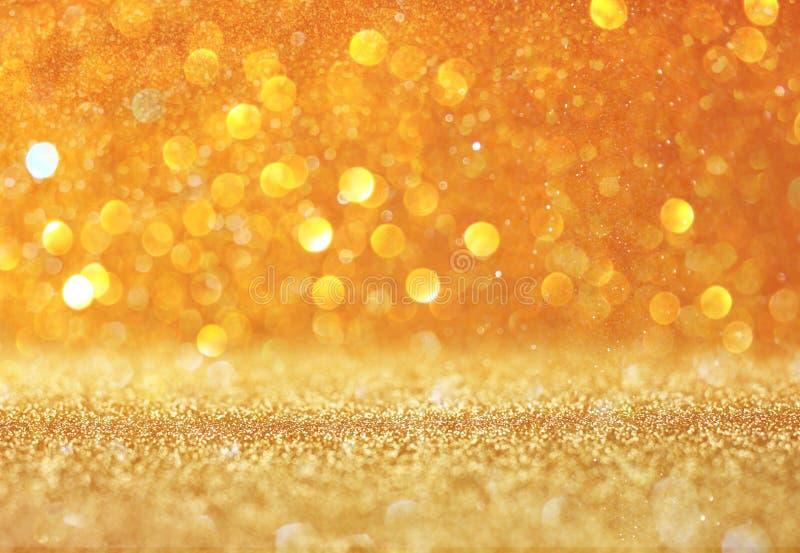 Fondo astratto dell'oro con lo spazio della copia luci del bokeh del gliiter fotografia stock libera da diritti