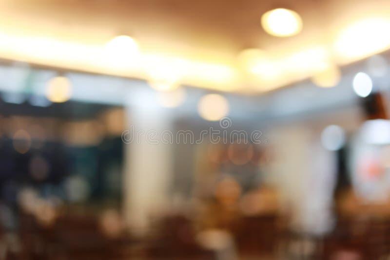 Fondo astratto della sfuocatura del caffè dei ristoranti immagini stock libere da diritti