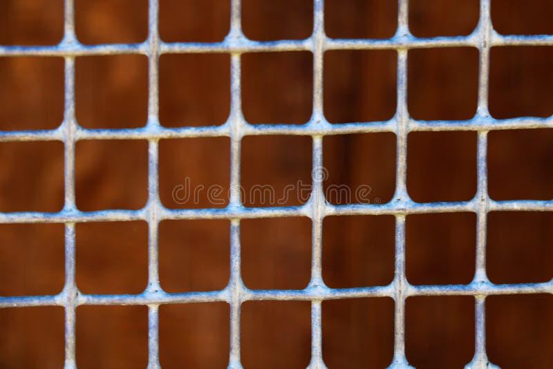 Fondo astratto di struttura d'acciaio arrugginita del fondo della maglia fotografia stock