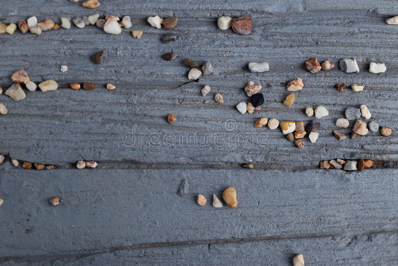 Fondo astratto di struttura del cemento con piccola ghiaia immagini stock