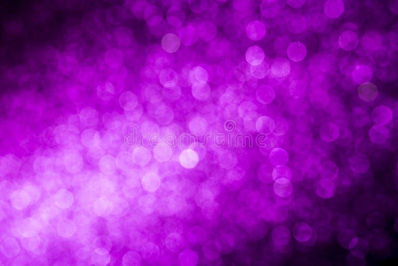 Fondo astratto porpora unfocused luminoso del bokeh fotografia stock