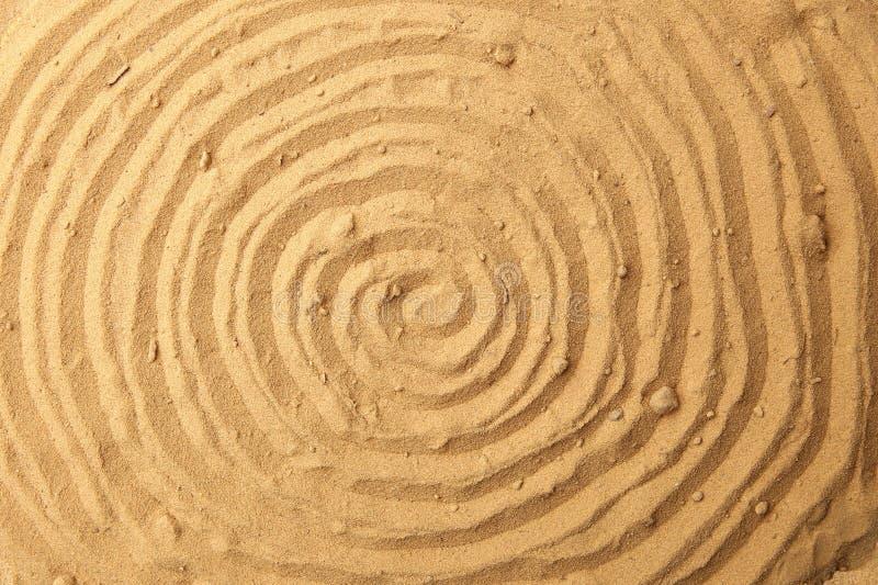 Fondo attingente a spirale della sabbia della spiaggia immagine stock