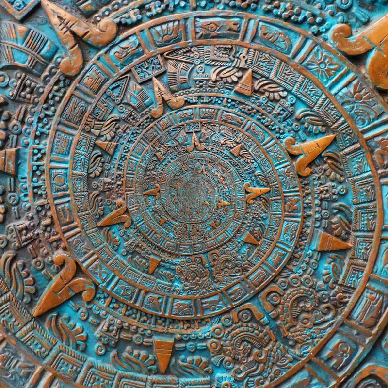 Fondo azteca espiral clásico antiguo antiguo de bronce del diseño de la decoración del modelo del ornamento Backg abstracto del e fotografía de archivo
