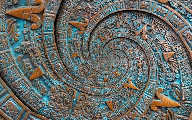 Fondo azteca espiral clásico antiguo antiguo de bronce del diseño de la decoración del modelo del ornamento Fractal abstracto sur imagen de archivo