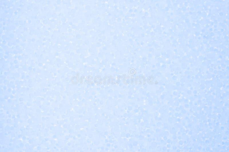 Fondo azul claro de la espuma de poliestireno fotos de archivo