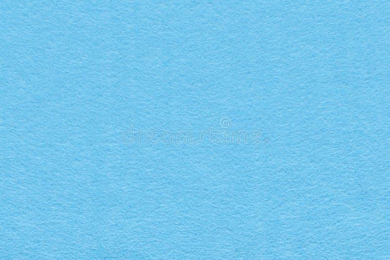 Fondo azul claro de la textura del fieltro foto de archivo