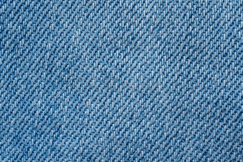 Fondo azul de la textura del modelo de la tela vista superior del paño de los vaqueros foto de archivo libre de regalías