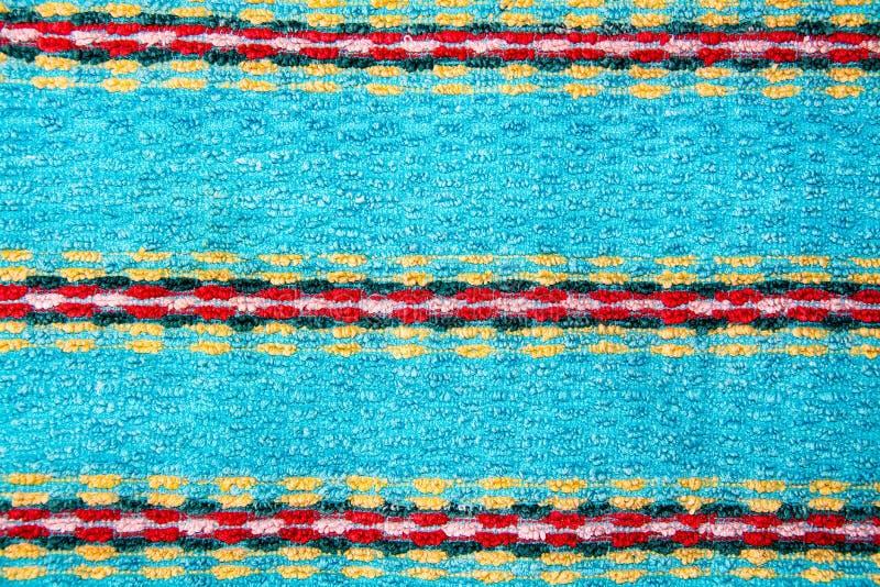 Fondo azul de Terry con las tiras coloreadas de paño imagen de archivo libre de regalías