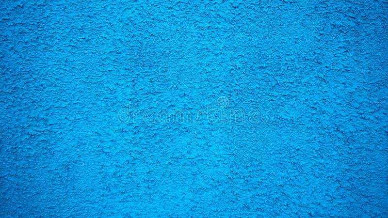 Fondo azul del estilo del vintage del estuco de la pared Superficie pintada, un edificio concreto viejo en ciudad imagen de archivo