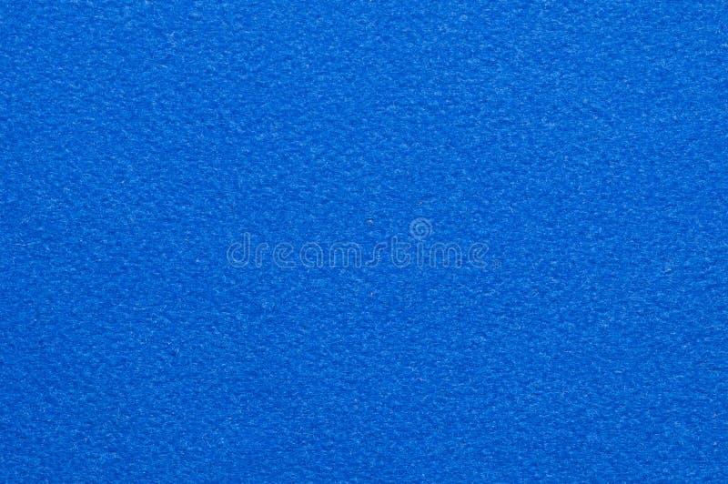 Fondo azul del terciopelo fotografía de archivo