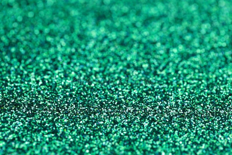 Fondo azulverde del brillo de la chispa de la turquesa Textura del extracto del día de fiesta, de la Navidad, de las tarjetas del imagenes de archivo