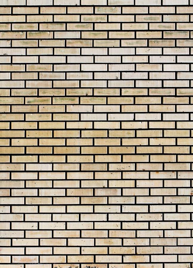 Fondo beige del extracto de la pared de ladrillo imagenes de archivo