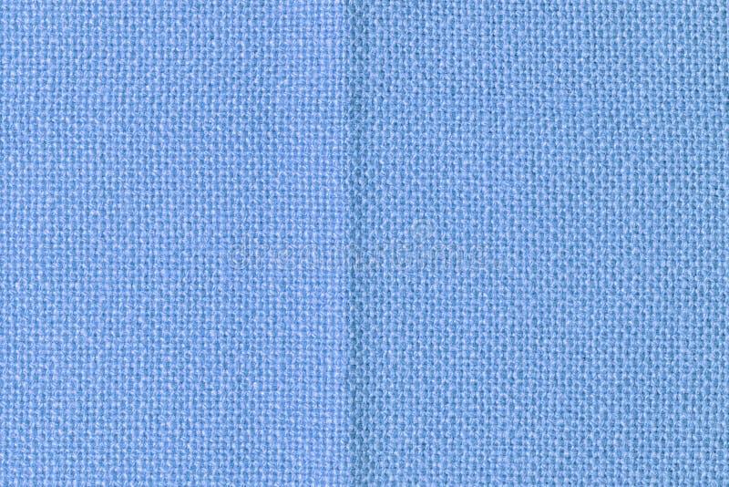 Fondo in bianco astratto per le disposizioni Fine blu grezza del tessuto su immagini stock