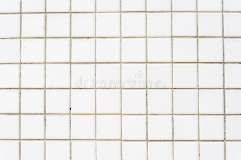 Fondo bianco della parete delle mattonelle fotografia stock