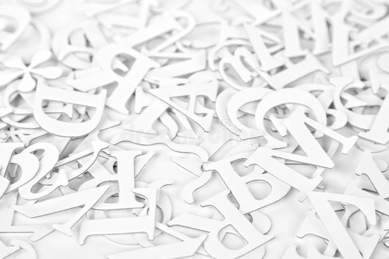 Fondo bianco delle lettere latine fotografia stock libera da diritti
