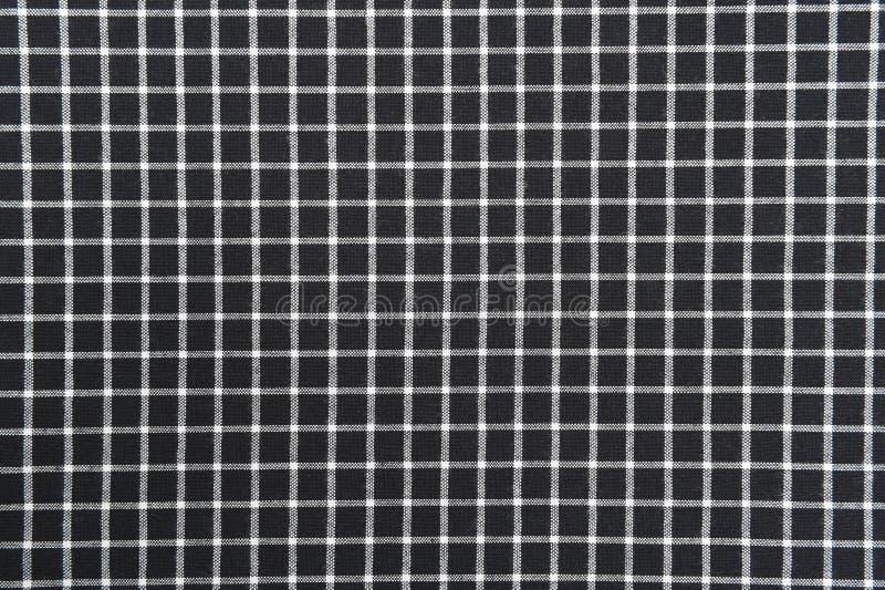Fondo in bianco e nero del panno del percalle con struttura del tessuto fotografie stock
