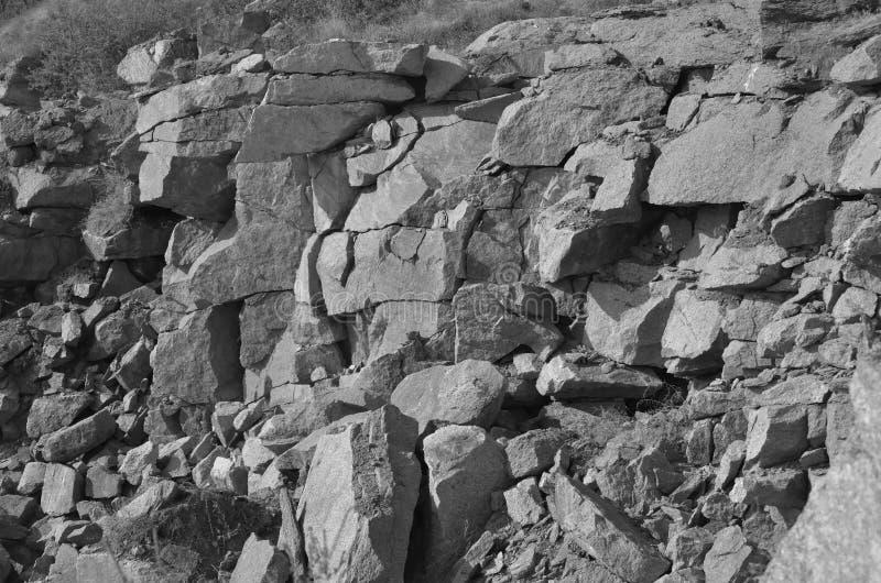 Fondo in bianco e nero delle pietre di carriera Struttura immagini stock