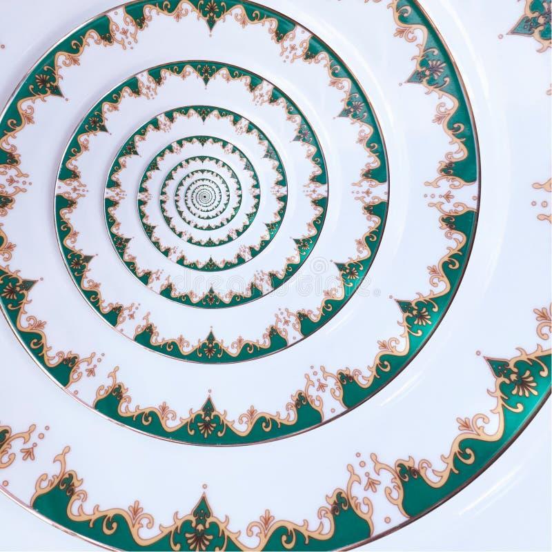 Fondo blanco del modelo del fractal del extracto del efecto del espiral del plato del ornamento del color del oro verde Fractal b imagen de archivo libre de regalías