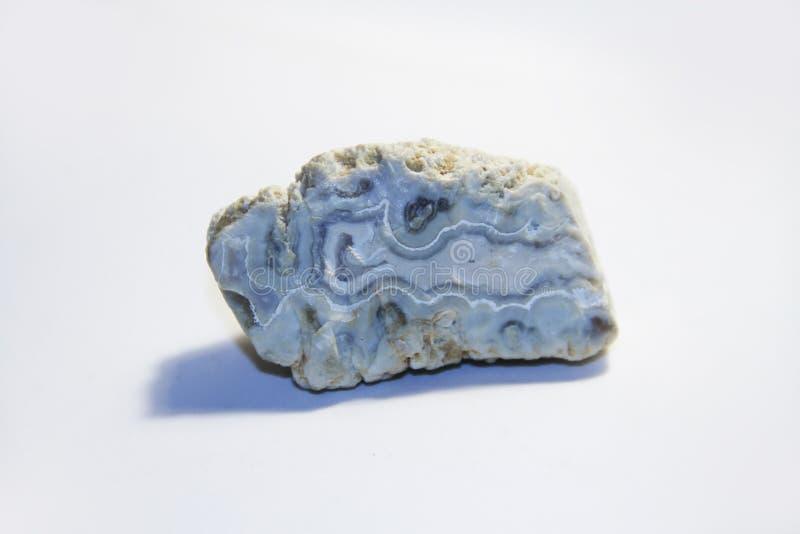 Fondo blanco, piedra fósil imagen de archivo