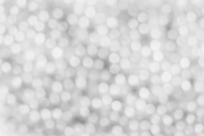 Fondo blanco y de plata de la luz del extracto del bokeh imagen de archivo
