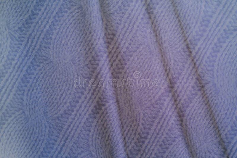 Fondo blu del tessuto nello stile d'annata -- tessuto corrugato sgualcito con le onde e tricottato strutturato fotografia stock