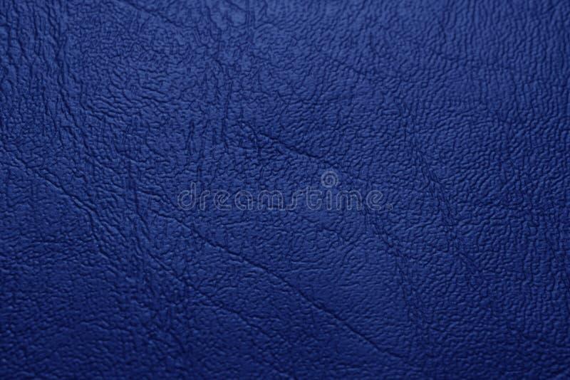 Fondo blu di struttura del cuoio genuino immagini stock