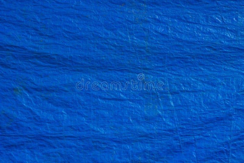 Fondo blu di struttura del tessuto delle tele cerate fotografie stock