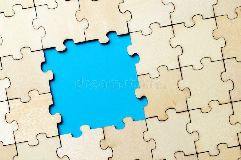 Fondo blu fatto dal puzzle fotografia stock libera da diritti