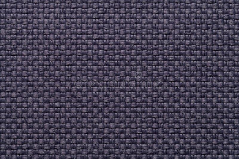Fondo blu scuro del tessuto con il modello a quadretti, primo piano Struttura della macro del tessuto fotografia stock