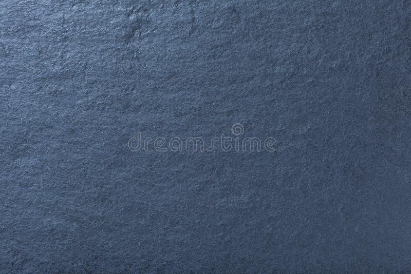 Fondo blu scuro dell'ardesia naturale Struttura della pietra fotografia stock libera da diritti