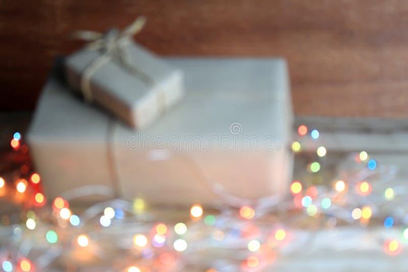 Fondo borroso: Cajas de regalo en luz del bokeh fotografía de archivo libre de regalías