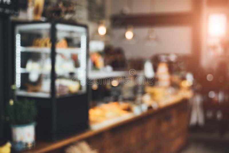 Fondo borroso de la panadería y de la cafetería Comida y concepto del restaurante Tema de trabajo del Co fotografía de archivo
