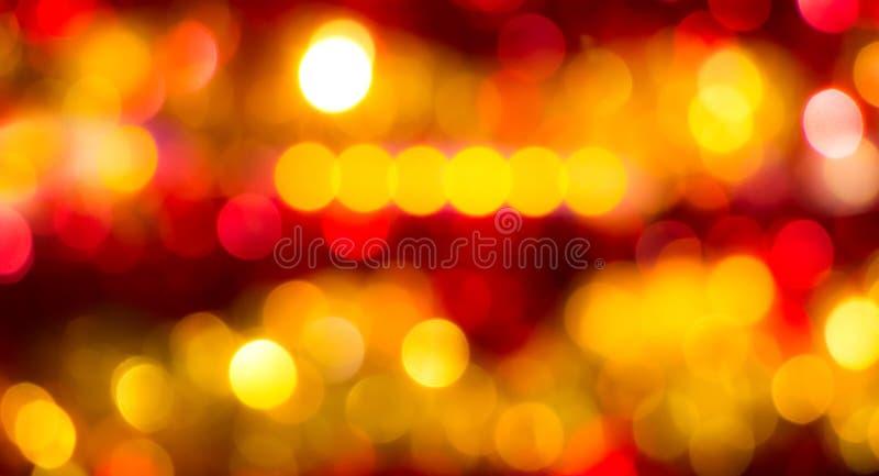 Fondo borroso festivo del extracto con el bokeh brillante amarillo y el red_ fotografía de archivo