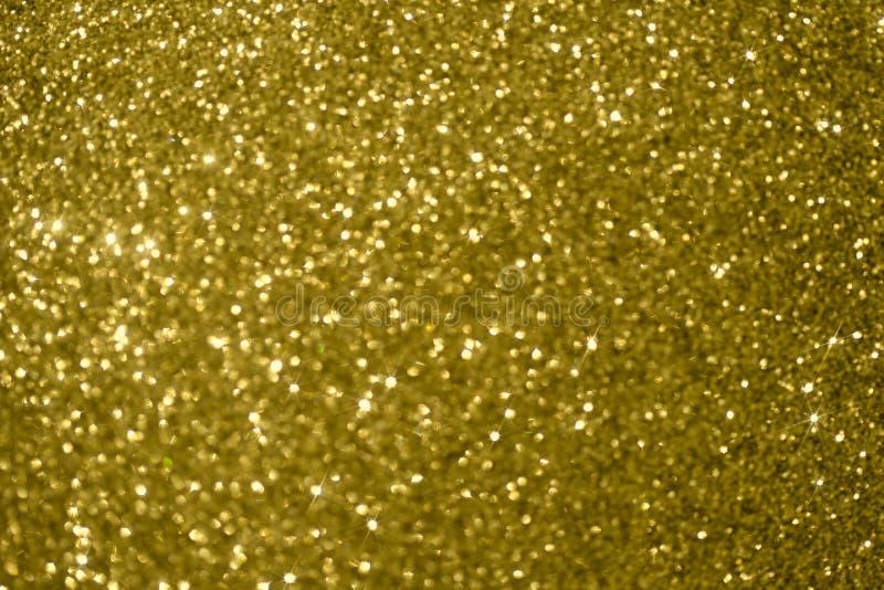 Fondo borroso, textura de oro de la Navidad imagen de archivo