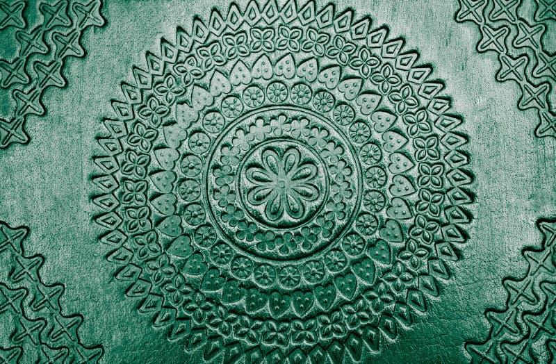 Fondo brillante tallado metálico hermoso del metal del oro con textura hermosa fotografía de archivo