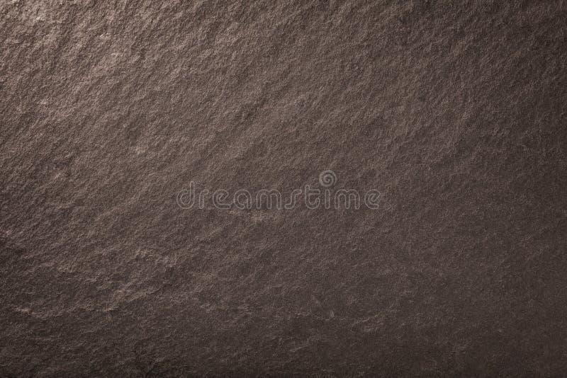Fondo bronzeo scuro dell'ardesia naturale Struttura della pietra immagini stock libere da diritti