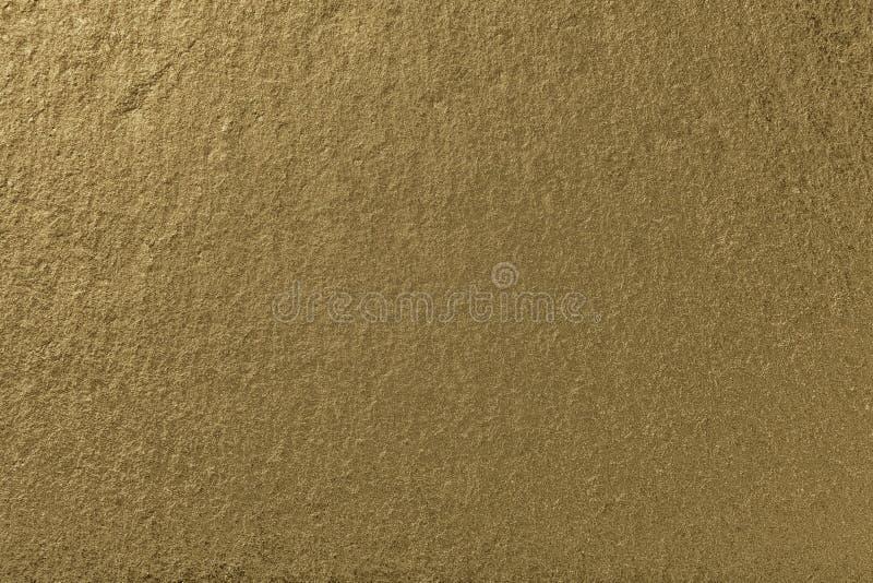 Fondo bronzeo scuro dell'ardesia naturale Struttura della pietra dorata immagine stock libera da diritti