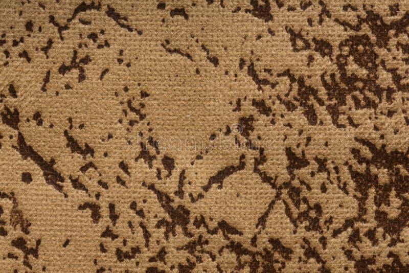 Fondo chiazzato del tessuto nella tonalità di beige-Brown immagine stock libera da diritti
