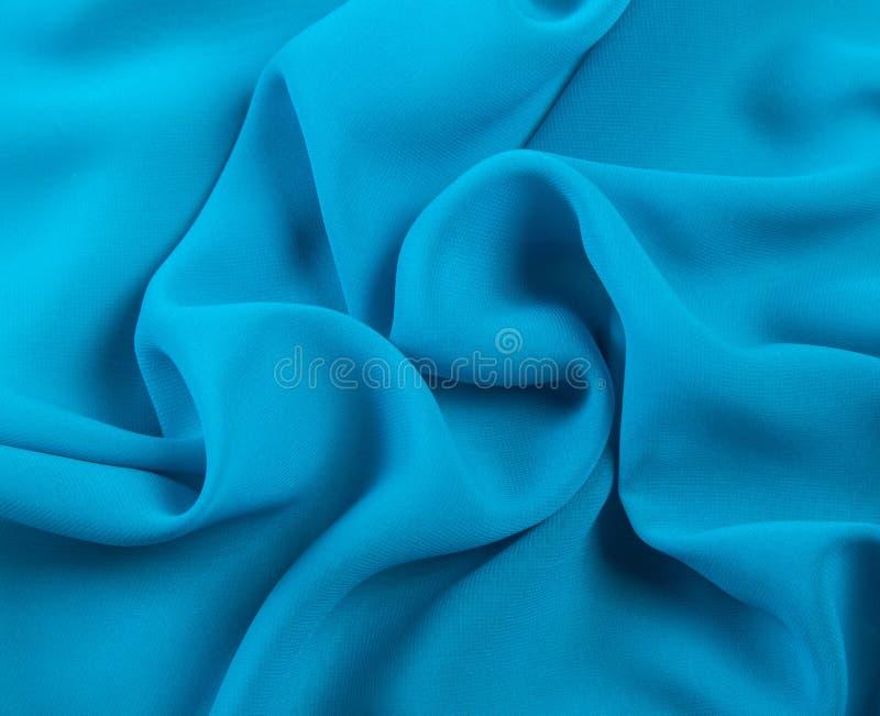 Fondo chiffon blu coperto luminoso fotografia stock