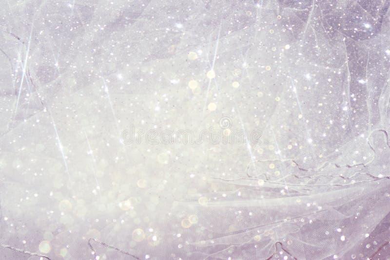 Fondo chiffon d'annata di struttura di Tulle con la sovrapposizione di scintillio Arco della stella blu con il nastro blu (involu immagini stock